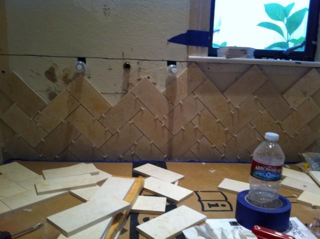 Herringbone tile installation startwithfourwalls.com