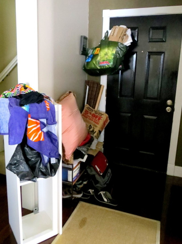 A cluttered small entryway mess.