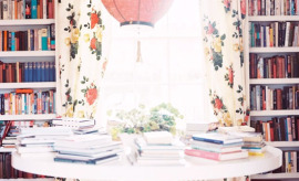 bookcases and floral drapes in dining area