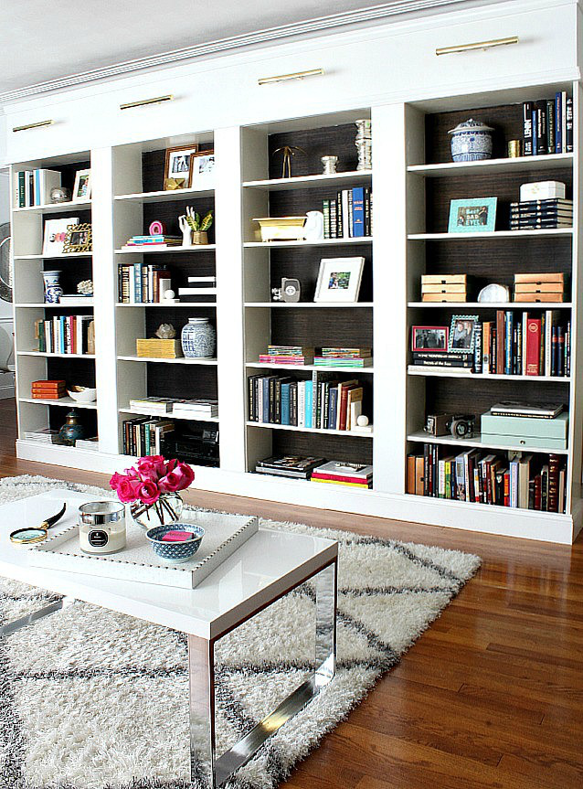 Ikea bookshelves with grasscloth backing
